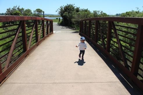 Crossing a small bridge over Adobe Creek.